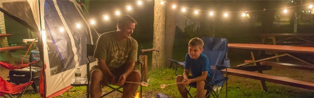 park campground father and son around fire pit